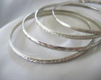 Stackable Bangle Bracelets Silvertone Set of Four 5mm wide 1980s