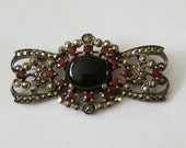 Vintage Sterling Silver Black Onyx Garnet and Marcasite Bow Tie Pin or Brooch