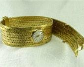 Circa 1950's Ladies Gubelin Bracelet Watch in 18KT Yellow Gold.