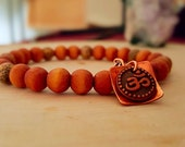 Wood beaded bracelet lotus seed beads OM symbol copper flower charm yoga spiritual jewelry, layering, stacking, gift gorgeous her
