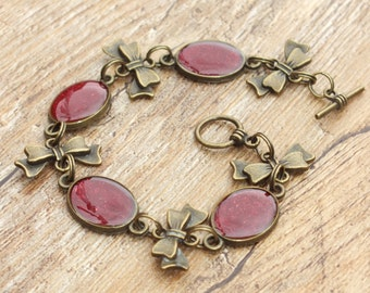 Bronze Tone Vintage Theme Deep Red and Bronze Bow Oval Link Bracelet Hand Painted Resin Glaze