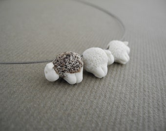 Necklace with 3 sheep - 1 black 2 white in porcelain flock of sheep with the black sheep