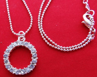 "Vintage 18"" silver tone necklace with 1"" rhinestone circle pendant in great condition, appears unworn"