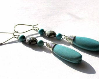 Turquoise Long Briolette Earrings with Silver Fish Accents