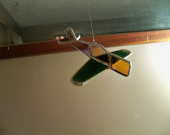 small vintage stain glassed airplane