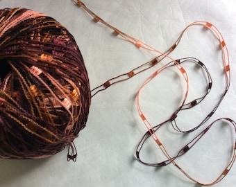 Spices Binario - Trendsetter Ladder Ribbon Yarn #107 - 25 gram 82 yards - Orange, Copper, Maroon, Browns, Burgundy, Salmon Pinks