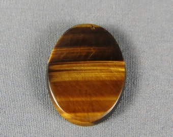 Golden Tiger Eye nice chatoyant golden cabochon