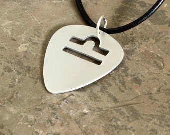 Zodiac guitar pick necklace with personalized horoscope cut out -