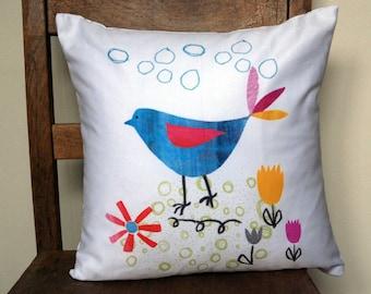 Blue Bird Tending to his Paper Garden Throw Cushion. Scatter Cushion. Throw Pillow. Pillow.