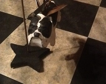 Carved black and white bulldog with metal wings and hook