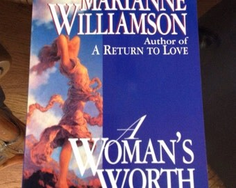A vintage copy of A Woman's Worth by Marianne Williamson.