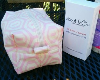 Cosmetic bag in pale pink and beige with pink and white gingham lining