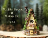 Fairy House of Giddings Hill - Miniature Pearl Yellow and Stone Facade Woodland House with Shingle Roof, Chimney and Blooming Flower Boxes