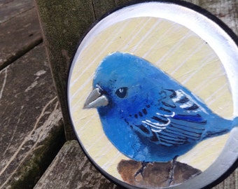 Painted bird circular wall plaque
