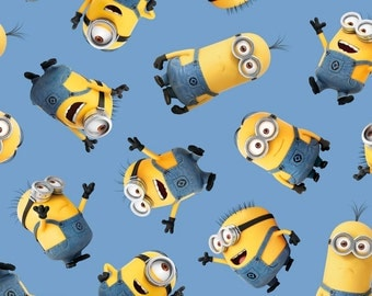 Blue Tossed Minions Fabric from Quilting Treasures - 26 inches