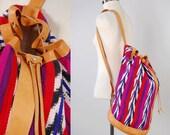 Vintage IKAT cotton Guatemalan drawstring bag / Guatemalan fabric and leather backpack / Ethnic cross body travel bag