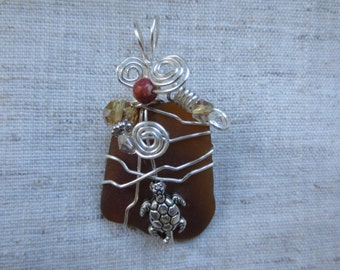 Beautiful silver plated wire wrap and crystal beads Florida brown sea glass with silver tone turtle embellishment pendent. Lot of 1 pendent.