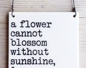 porcelain wall tile screenprinted text a flower cannot blossom without sunshine & man cannot live without love. -max muller