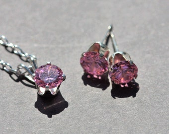 Pink cubic zirconia pendant and earrings set.