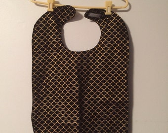 Adult clothing bib, clothing protector, black and gold.