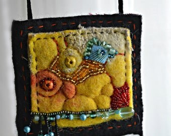 Colorful Felted wool necklace decorated with embroidery and beads