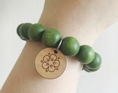 Apple green, wooden bead bracelet with engraved rosewood flower charm - nontoxic - natural