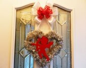 Valentines silver tinsel heart shaped wreath red felt cupid center white bow with red heart center