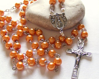 Handmade Catholic rosary with orange glass pearls in silver