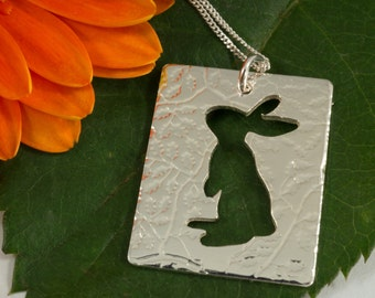 Silver rabbit pendant: A Curious bunny stands up to look around at the world.