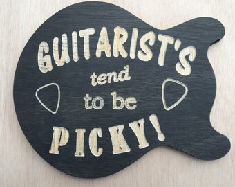 Guitar shaped wall plaque.