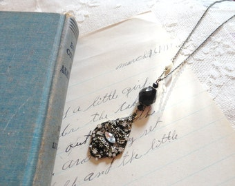 Black and white themed decorative rhinestoned pendant necklace with jet black and pearl bead accents, Darkest Night