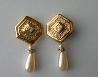 Swarovski dangle drop clip-on earrings. Gold plate metal, rhinestone, faux pearl.