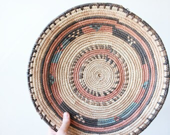 vintage woven basket, wall hanging