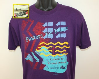 Pastors for Peace vintage t-shirt M/L purple 80s Screen Stars Caravan to Central America