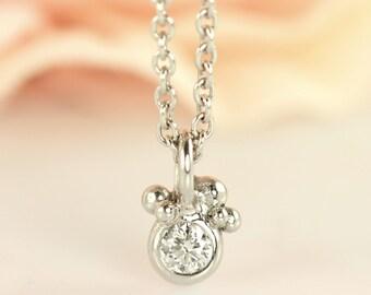 PETITE Subtle Diamond Pendant with surrounding bubbles