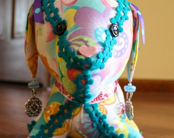 Decorative Stuffed Dog in Multi-Colored Fabric with Fairies and Flowers