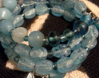 Light Blue Glass Beaded Memory Wire Wrap Bracelet with Isis Charm
