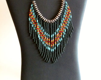 Native American beaded necklace in greens,  turquoise, marigold and red