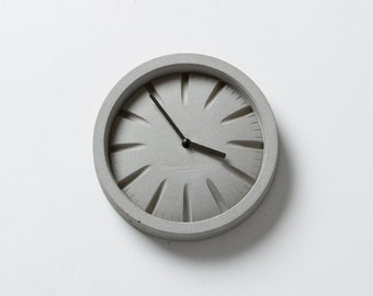 PO Concrete Clock with Black Hands by Plywood Office