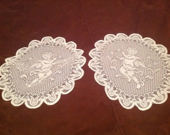 Set of vintage lace doilies with CHERUBS,roses and scroll design