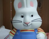 """Max.  Bunny Plastic Bank. Plays Theme Music From The TV Show """"Max and Ruby"""". Made By Buzz Bee Toys."""