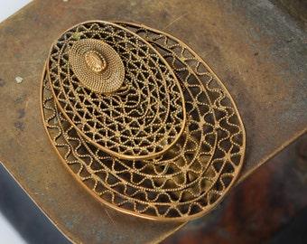 Vintage filigree brass clip brooch.