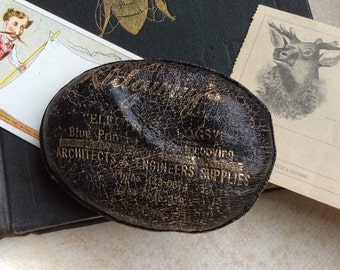 Engineers & Architects Might Dig This Vintage Leather Advertising Paperweight
