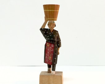 Vintage Japanese Ainu hand carved wood figure, woman in kimono carrying water