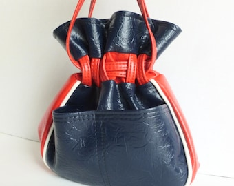 Red, White and Blue Vinyl Drawstring Bucket Purse Handbag with External Pockets