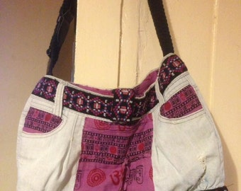 Up-cycled bag made from denim skirt, pink trousers and belt.