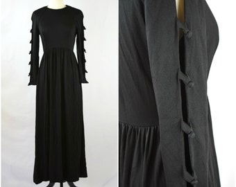 Vintage Elinor Gay 60s black maxi dress with long open buttoned sleeves
