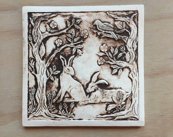 Rabbits resting in the rose garden eight inch porcelain tile in chocolate brown, moroccan red and turquoise
