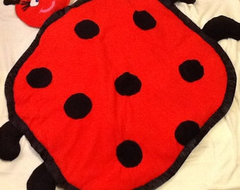 It's a ladybug weighted blanket!!