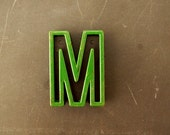 """Vintage Industrial Letter """"M"""" Black with Green and Blue Paint, 2"""" tall (c.1940s) - Monogram Display, Shadow Box Letter, Art Supply"""